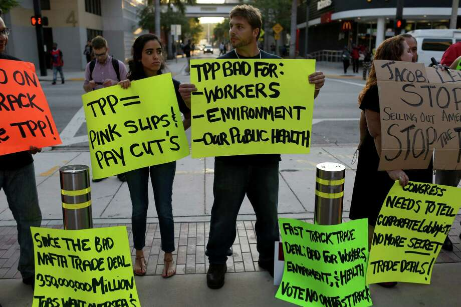 Union members and community activists protest outside the Miami Dade College where the Greater Miami Chamber of Commerce and the college were hosting a moderated conversation with U.S. Secretary of the Treasury Jacob Lew on March 20, 2015 in Miami, Florida. The protesters are against the Trans-Pacific Partnership (TPP) which is a proposed twelve-nation pact and are asking the Federal Government and Florida Congressional delegation to reject fast tracking the TPP and warn that the deal poses serious risk to jobs and wages, the environment, food safety and public health for Floridas working families.  (Photo by Joe Raedle/Getty Images) Photo: Joe Raedle / Getty Images / 2015 Getty Images