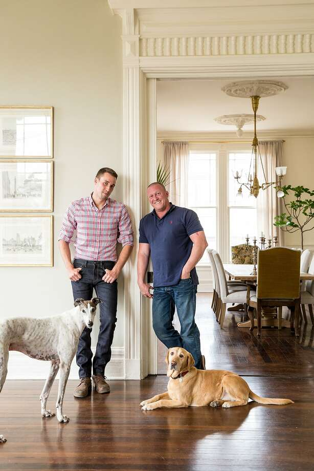 Josh Stenzel (left) and Steve Kopff and Josh Stenzel, with Kobe and Bacon, in their Oakland Victorian. Photo: Aubrie Pick, Special To The Chronicle