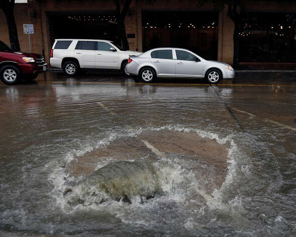 Commerce Street downtown  Water gushes from a manhole on Commerce street high water due to heavy rains Friday, Dec. 19, 2014, in Houston. Photo: James Nielsen, Houston Chronicle File / © 2014  Houston Chronicle
