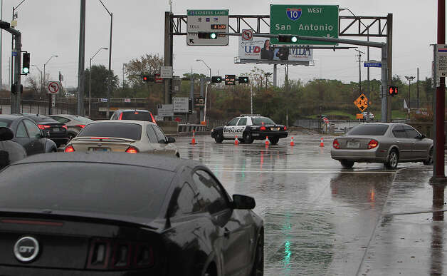Interstate 10 entrance from Louisiana Street in downtown  A police car blocks off the Interstate 10 west on ramp where Louisiana street intersects with I-10 due to high water due to heavy rains Friday, Dec. 19, 2014, in Houston. Photo: James Nielsen, Houston Chronicle File / © 2014  Houston Chronicle