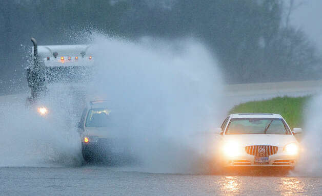 Farm-to-Market 1488 (Conroe)   Traffic makes its way through high water north of Farm-to-Market 1488 Wednesday, Jan. 25, 2012, in Conroe. Photo: Cody Duty, Houston Chronicle File / © 2011 Houston Chronicle