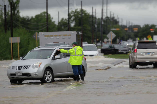 South Mayde Creek area (Katy)   Cutter Urban, an oil and gas worker, helps police direct traffic out of high-water at the intersection of Greenhouse Road and Saums Road on Friday, Sept. 19, 2014, in Katy. The flooding was caused by South Mayde Creek overflowing from its banks. Photo: Mayra Beltran, Houston Chronicle File / © 2014 Houston Chronicle