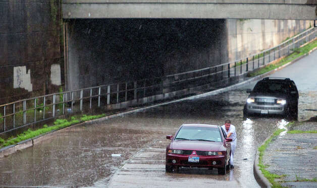 Studewood Street near Washington Avenue  A man pushes his car after it stalled out in high water along Studewood, North of Washington Avenue, Tuesday, Sept. 16, 2014, in Houston. Photo: Cody Duty, Houston Chronicle File / © 2014 Houston Chronicle