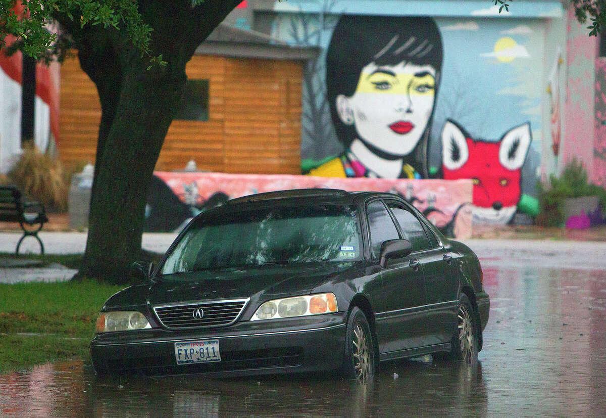 White Oak Drive near Beauchamp Street A car sits in high water along White Oak Drive near Beauchamp Street, Tuesday, May 13, 2014, in Houston. (Cody Duty / Houston Chronicle)