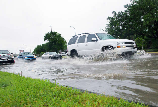 Fondren Road and Southwest Freeway  Vehicles make their way through high water along Fondren near the Southwest Freeway, Tuesday, May 13, 2014, in Houston. (Cody Duty / Houston Chronicle) Photo: Cody Duty, Houston Chronicle File / © 2014 Houston Chronicle
