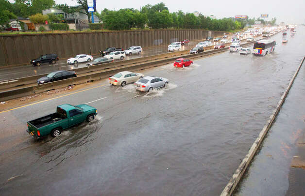 North Freeway near N. Main Street exit  Vehicles make their way through high water along the North Freeway near N. Main, Tuesday, May 13, 2014, in Houston. (Cody Duty / Houston Chronicle) Photo: Cody Duty, Houston Chronicle File / © 2014 Houston Chronicle