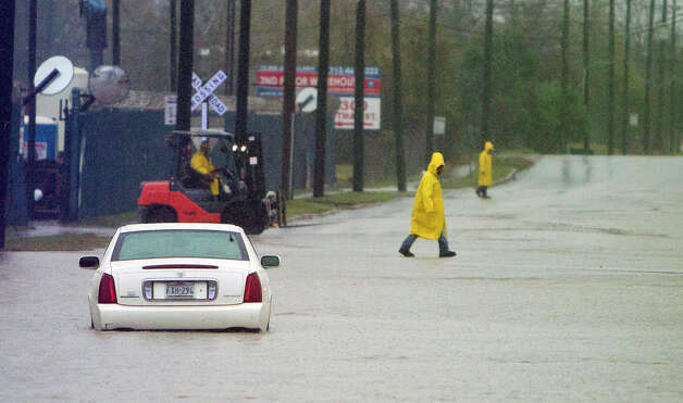 Quitman Street  A car sits in high water along Quitman Street, Friday, Dec. 19, 2014, in Houston. (Cody Duty / Houston Chronicle) Photo: Cody Duty, Houston Chronicle File / © 2014 Houston Chronicle