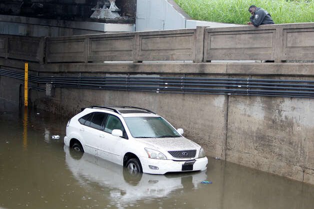 Polk Street near Cullen Boulevard  A Lexus drove into high water along Polk St. near Cullen Blvd. east of Downtown Houston during the heavy rain this morning on Friday, July 13, 2012, in Houston. Photo: Mayra Beltran, Houston Chronicle File / © 2012 Houston Chronicle
