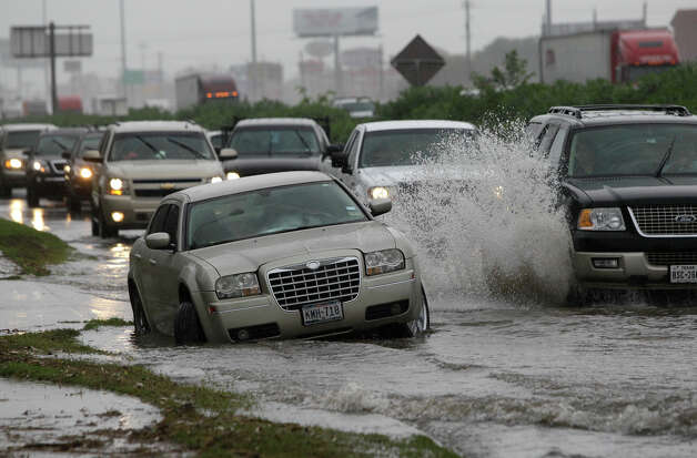 Interstate 45 near Crosstimbers  Vehicles move past a stalled car in the high water along the I-45 northbound feeder near Crosstimbers Thursday, Oct. 31, 2013, in Houston. ( Melissa Phillip / Houston Chronicle ) Photo: Melissa Phillip, Houston Chronicle File / © 2013  Houston Chronicle