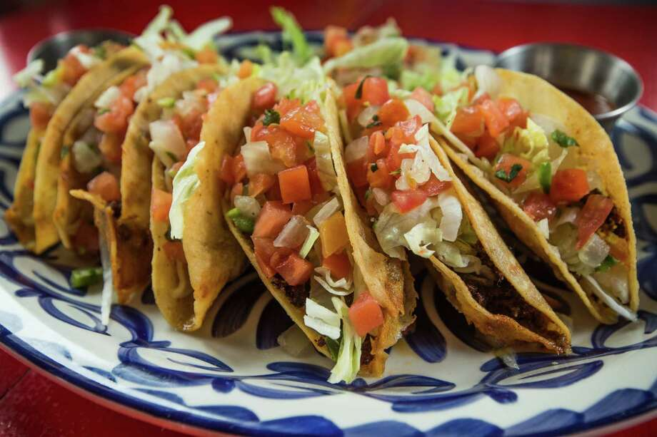 The El Cantina Superior's J 'n B Dorado tacos are deep-fried and stuff with ground beef. Photo: Brett Coomer, Staff / © 2015 Houston Chronicle