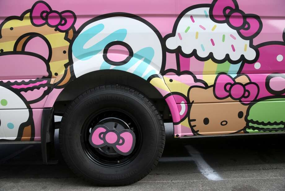 Super cute bows adorn the tires on the Hello Kitty Truck. Photo: Photo: Paul Chinn/The Chronicle, The Chronicle