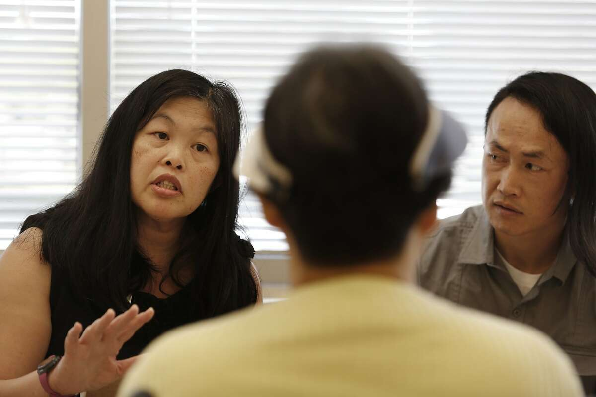 Linda Huie (left), renal dietician, and Xuong Luu (right) talk with Luu's mother Hanh Nguyen (center) about her water intake after her dialysis treatment at DaVita Silicon Valley Dialysis on Thursday, March 19, 2015 in San Jose, Calif.
