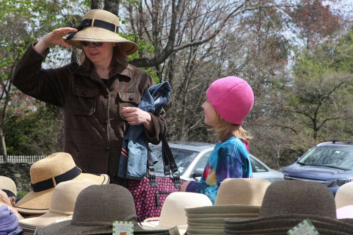 Sabine Schwercer and her daughter, Ameliia Elsa, 6, of Norwalk, shop for hats at the Greenfield Hill Church Dogwood Festival in Fairfield, Conn. on Sunday, May 4, 2014.