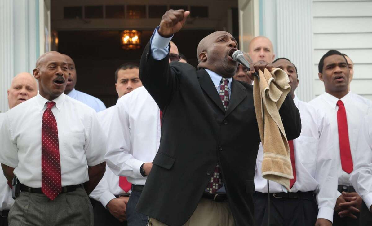 DeWitt Harmon leads the Pivot Ministries Men's Choir's performance at the Greenfield Hill Church Dogwood Festival in Fairfield, Conn. on Sunday, May 4, 2014.
