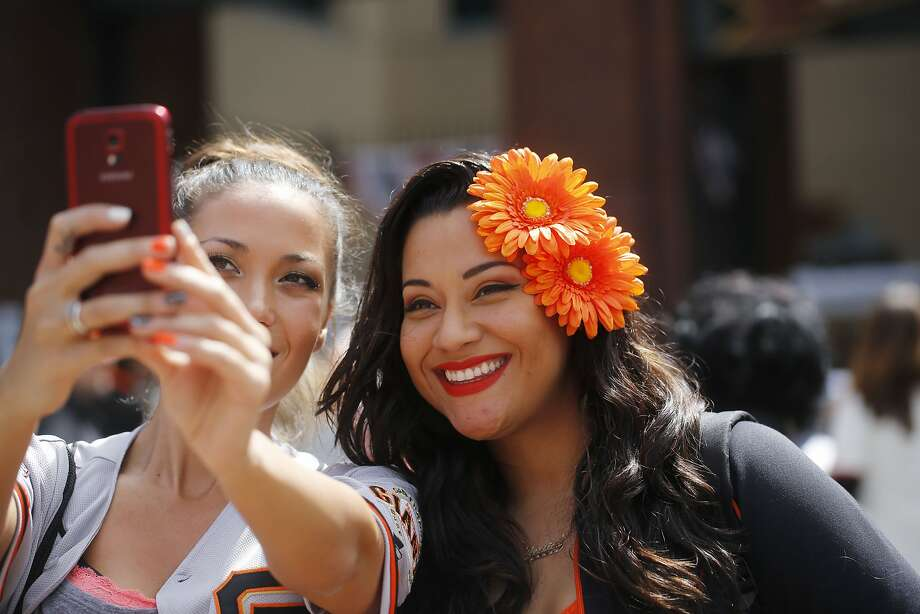 Danielle Bachler and Jessica Bonilla commemorate the day before heading into AT&T park for the San Francisco Giants opening day on Monday April 13, 2015 in San Francisco, Calif. Photo: Mike Kepka, The Chronicle