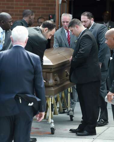 "The casket carrying the remains of Donald ""Dontay"" Ivy leaves  the Greater St. John's Church Monday morning April 13, 2015 in Albany, N.Y.   (Skip Dickstein/Times Union) Photo: SKIP DICKSTEIN / 00031346A"