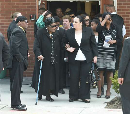 "Mourners leave the Greater St. John's Church Monday morning April 13, 2015 in Albany, N.Y. after the funeral ceremony of Donald ""Dontay"" Ivy.    (Skip Dickstein/Times Union) Photo: SKIP DICKSTEIN / 00031346A"