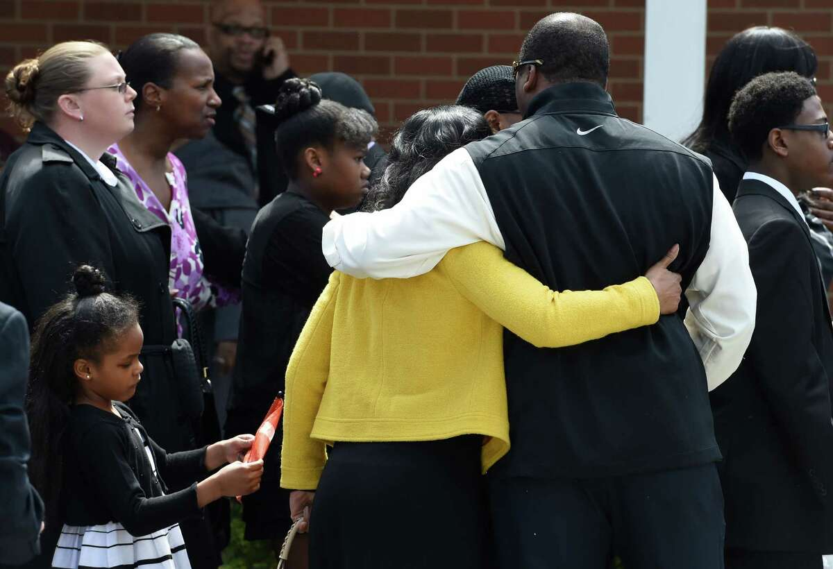 Mourners leave the Greater St. John's Church Monday morning April 13, 2015 in Albany, N.Y. after the funeral ceremony of Donald