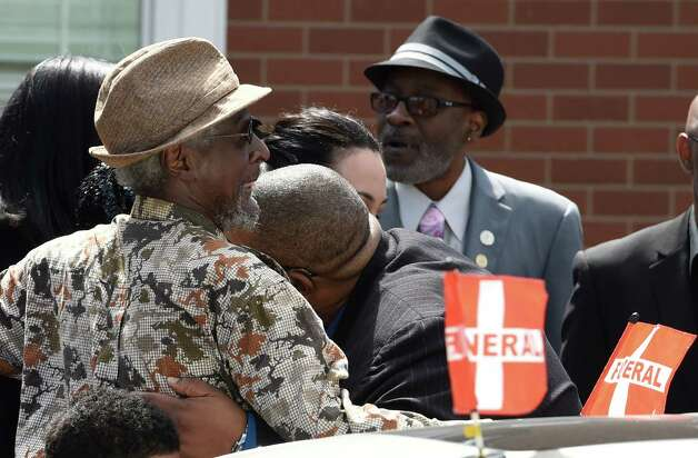 """Mourners leave the Greater St. John's Church Monday morning April 13, 2015 in Albany, N.Y. after the funeral ceremony of Donald """"Dontay"""" Ivy.    (Skip Dickstein/Times Union) Photo: SKIP DICKSTEIN / 00031346A"""