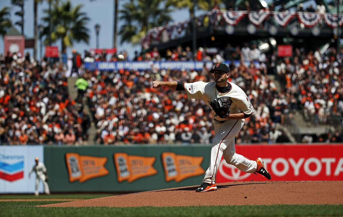 San Francisco Giants' Chris Heston throws first pitch to Colorado Rockies during Giants' home opener at AT&T Park in San Francisco, Calif., on Monday, April 13, 2015.