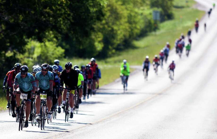 Cyclists ride along FM 529 towards Bellville on route to Austin during the BP MS150 in 2013. Photo: J. Patric Schneider, Freelance / © 2013 Houston Chronicle