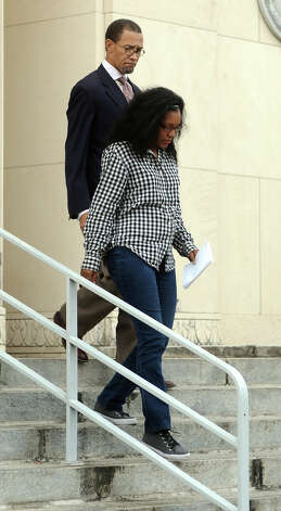 Kailyn DeShondra Pete leaves the federal courthouse on Thursday afternoon accompanied by Audwin Samuel. Pete, Daryl Glenn Johnson and Erin Johnson appeared in Judge Keith Giblin's court Thursday to change their pleas to guilty in charges relating to defrauding BISD of almost $300,000. Photo taken Thursday 12/4/14 Jake Daniels/The Enterprise Photo: Jake Daniels / ©2014 The Beaumont Enterprise/Jake Daniels