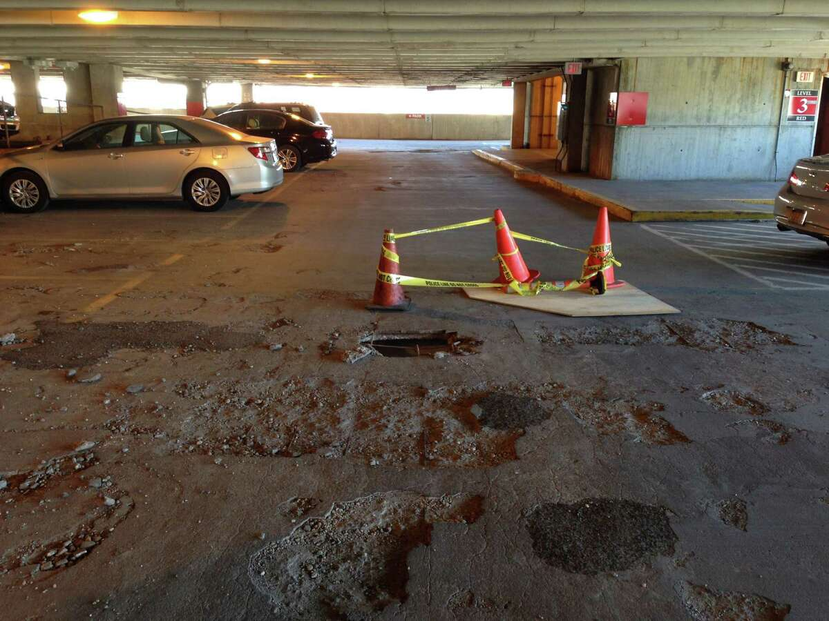 The Connecticut Department of Transportation closed the old section of the parking garage at the Stamford Transportation Center Monday, April 14, 2015, due to safety concerns after a chunk of concrete fell through to the floor below, leaving a gaping hole.