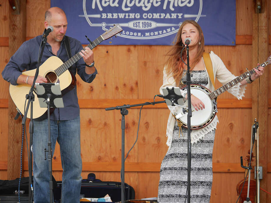 Father-and-daughter bluegrass combo Dave and Emma Hart will perform at the Unitarian Universalist Congregation, at 20 Forest St., Stamford, Conn., on Friday, April 17, starting at 8 pm. Tickets are $20 dollars at the door, or in advance at www.uustamford.org. Photo: Contributed Photo / Stamford Advocate Contributed photo