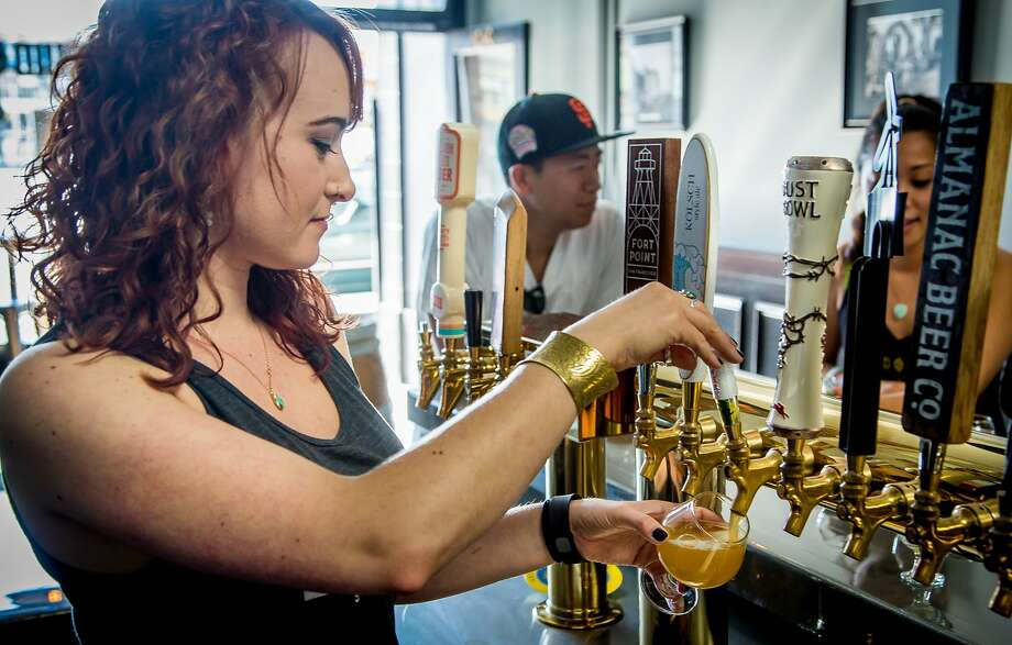 Bartender Kayleigh Bender pours a beer at Liquid Gold in San Francisco. Photo: John Storey, Special To The Chronicle