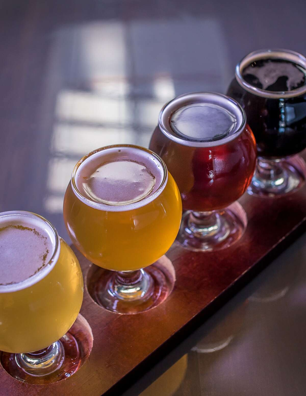 A beer flight, l-r; Half Moon Bay Kolsch, Holy Craft-Magnum Opus, Fort Point-Westfalia and Track 7-Unrelenting at Liquid Gold in San Francisco, Calif., is seen on Sunday, April 12th, 2015.
