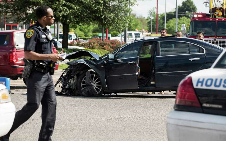 Police investigate the scene following a police chase at the intersection of Scott and Old Spanish Trail on Monday, April 13, 2015, in Houston. Photo: Brett Coomer, Houston Chronicle / © 2015 Houston Chronicle