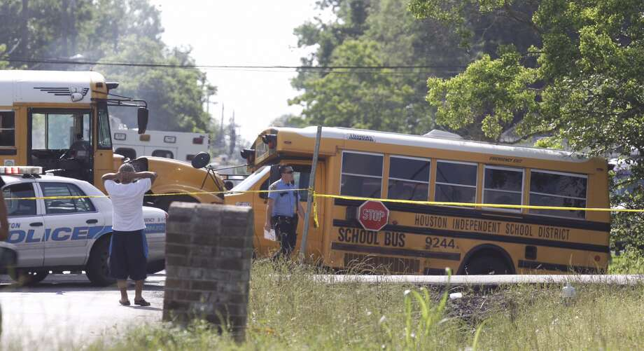 Two school buses collided at the corner of Bacher and Bonaire Monday afternoon. Photo: Melissa Phillip, Chronicle