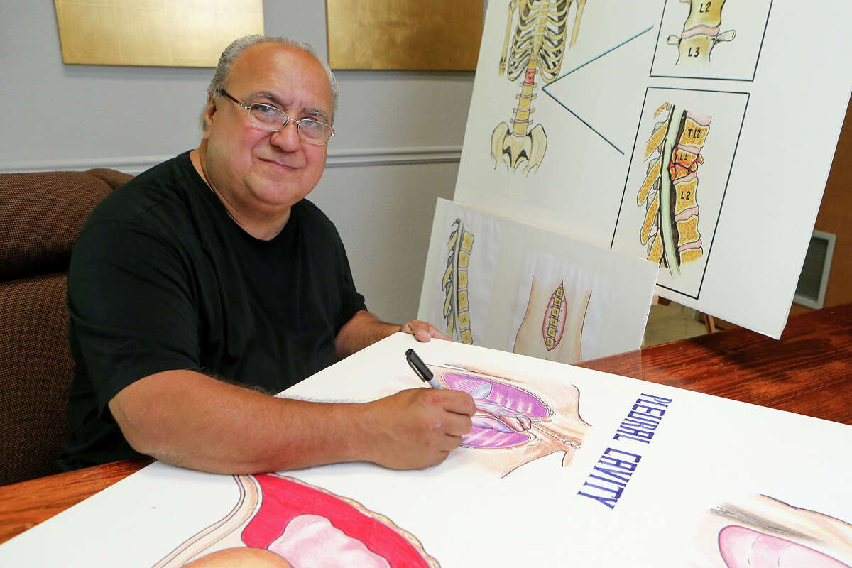 Antonio Barrera at the Law Offices of Pat Maloney on Saturday, April 11, 2015, where he has worked as an artist/illustrator for 32 years. Barrera designed this year's official Fiesta poster. MARVIN PFEIFFER/ mpfeiffer@express-news.net