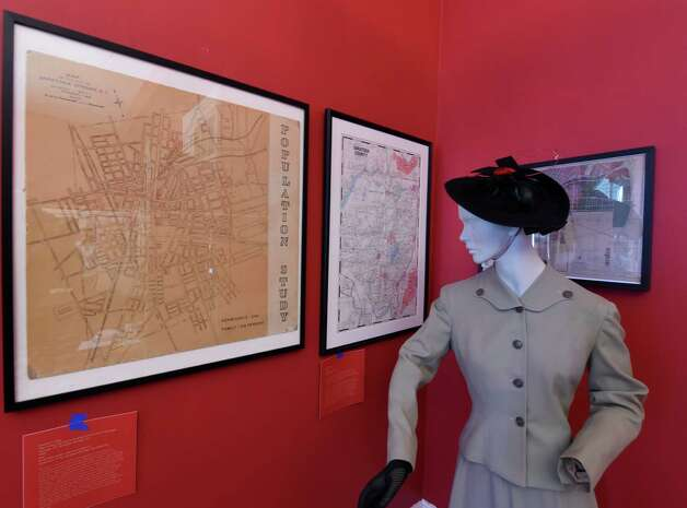 "A mannequin seems to be looking over at the display of ""Saratoga Springs in 250 Years of Maps"" Monday April 13, 2015 at the Saratoga Springs History Museum at the Canfield Casino in Saratoga Springs, N.Y.  The show of the historical maps will open Tuesday.    (Skip Dickstein/Times Union) Photo: SKIP DICKSTEIN / 00031392A"