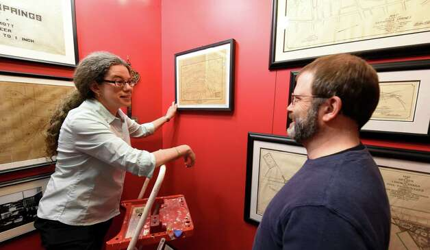 "Jordana Dym, associate professor of history at Skidmore, left  and James Parillo, executive director set up maps in the display of ""Saratoga Springs in 250 Years of Maps"" Monday April 13, 2015 at the Saratoga Springs History Museum at the Canfield Casino in Saratoga Springs, N.Y.  The show of the historical maps will open Tuesday.    (Skip Dickstein/Times Union) Photo: SKIP DICKSTEIN / 00031392A"