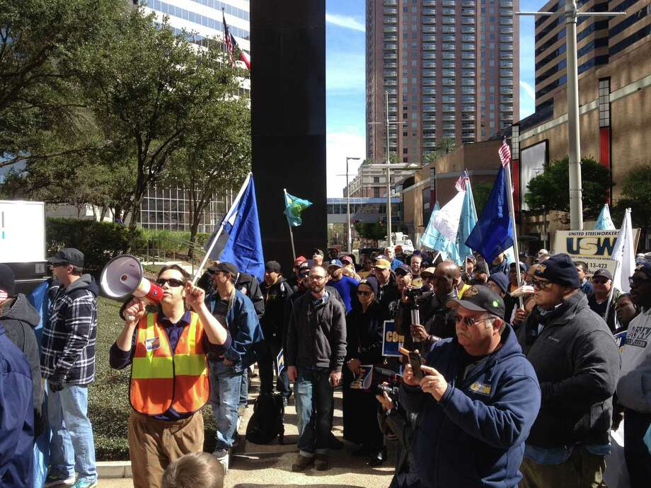 """Union supporters protest last month outside LyondellBasell offices downtown. Employees are gathering this week to hear the details of the company's """"last, best and final offer."""" Photo: Sarah Scully"""
