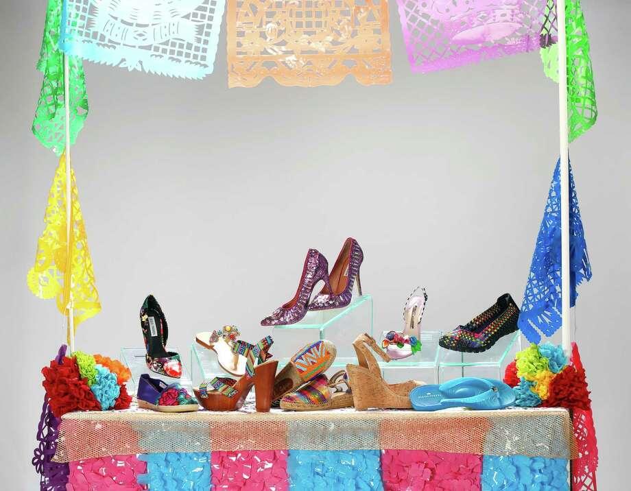 Shoes for the 11 days of Fiesta. Front row, left to right: Maka espadrille, $91, Nativa; Gianni Bini platform sandal, $79.99, Dillard's North Star Mall; Sam Edelman beaded flat, $195, Julian Gold; Toni Pons metallic espadrille, $125, Julian Gold; Elaine Turner cork wedge, $268, Elaine Turner Boutique; Elaine Turner jelly flip flop, $58, Elaine Turner Boutique. Back row, left to right: Steve Madden rose print pump, $89.99, Dillard's; Mystique blinged sandal, $200, Julian Gold; Steve Madden purple bling heels, $129.99, Dillard's; Sophia Webster floral heel, $595, Julian Gold; Sketchers sneaker, $54.99, Dillard's. Photo: William Luther /San Antonio Express-News / © 2015 San Antonio Express-News