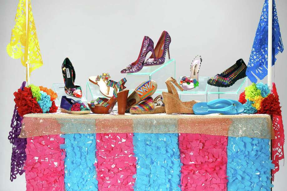 Shoes for the 11 days of Fiesta. Front row, left to right: Maka espadrille, $91, Nativa; Gianni Bini platform sandal, $79.99, Dillard's North Star Mall; Sam Edelman beaded flat, $195, Julian Gold; Toni Pons metallic espadrille, $125, Julian Gold; Elaine Turner cork wedge, $268, Elaine Turner Boutique; Elaine Turner jelly flip flop, $58, Elaine Turner Boutique. Back row, left to right: Steve Madden rose print pump, $89.99, Dillard's; Mystique blinged sandal, $200, Julian Gold; Steve Madden purple bling heels, $129.99, Dillard's; Sophia Webster floral heel, $595, Julian Gold; Sketchers sneaker, $54.99, Dillard's. Photo: William Luther /San Antonio Express-News / © 2015 San Antonio Express-News