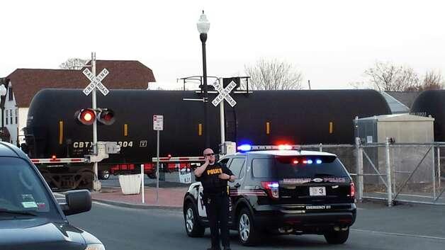 Police investigate a train-pedestrian crash in Colonie on Monday, April 13, 2015. (Eric Anderson/Times Union)