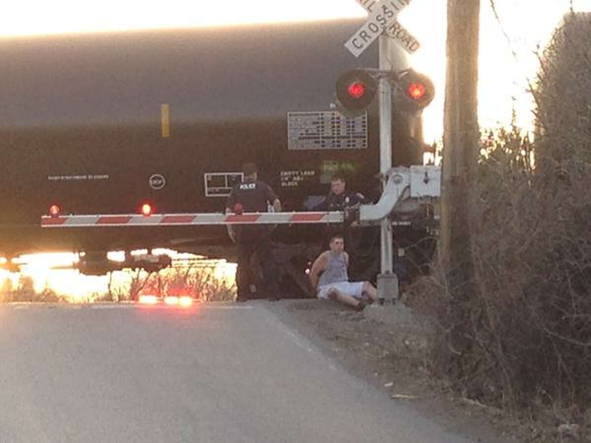 One man was injured and another detained after an oil train struck a person on the railroad tracks in Colonie on Monday, April 13, 2015. (Lori Van Buren/Times Union)