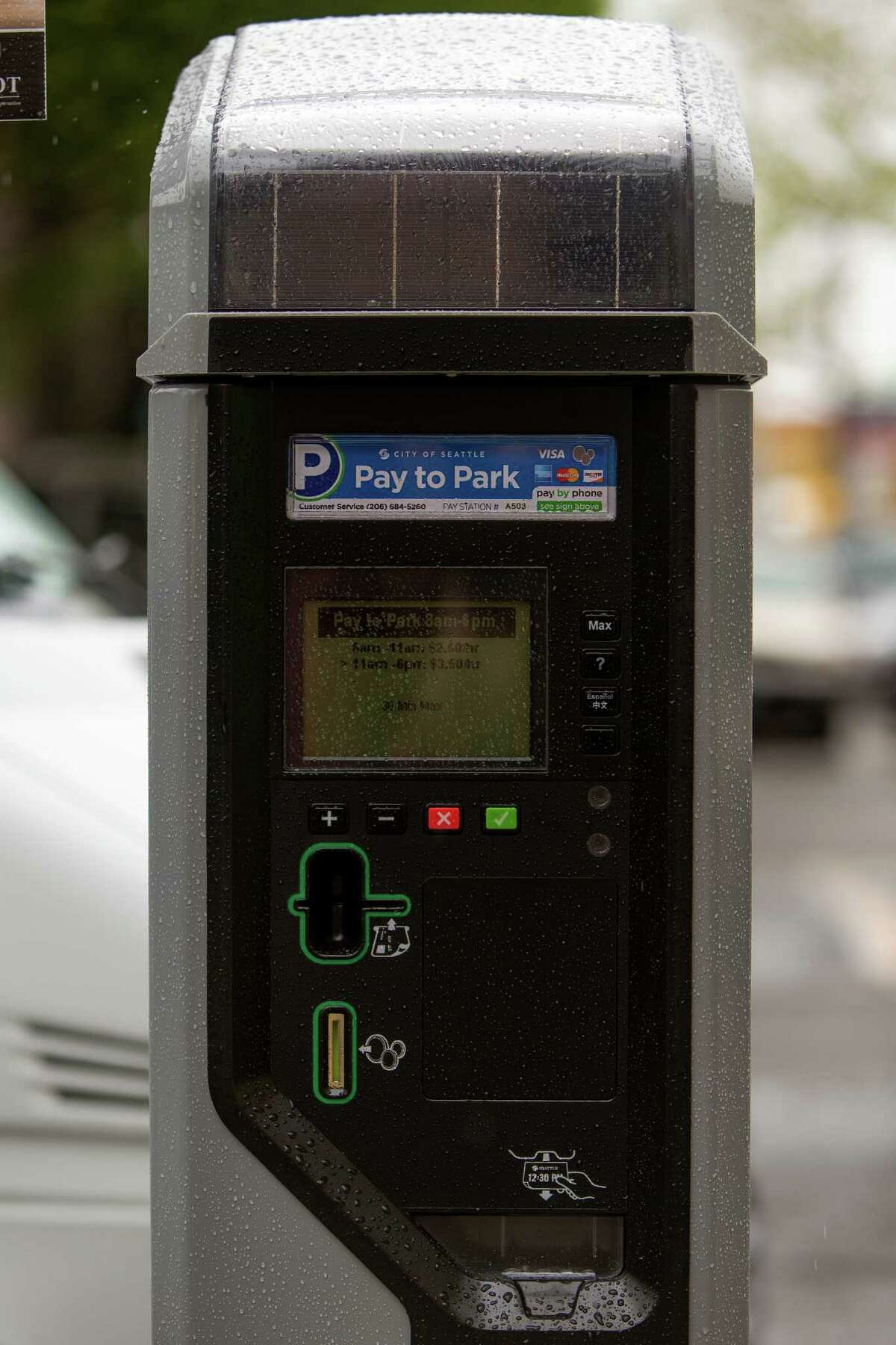 SDOT employees show off one of 2,200 new smart parking pay stations Monday, April 13, 2015, near CenturyLink Field in Seattle, Washington. The City of Seattle selected the IPS Group to replace or retrofit all of the city?•s on-street parking pay stations by the end of 2016, boasting a higher level of customer service, communications reliability and variable