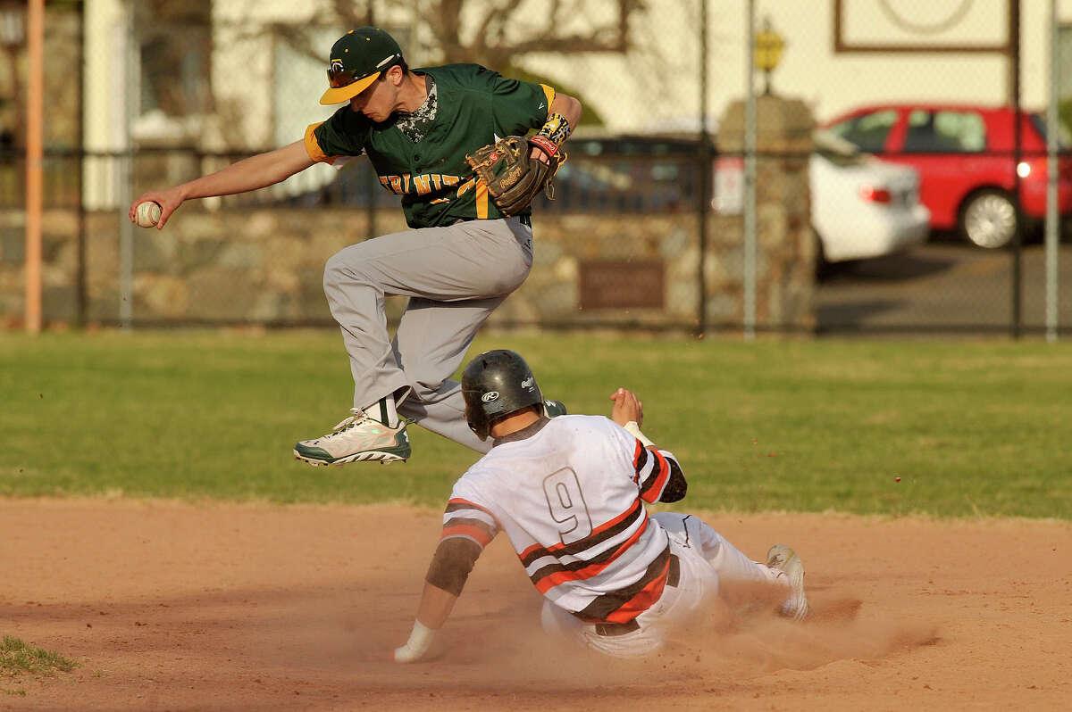 Trinity Catholic shortstop Matt Fraioli forces out Stamford's Tyler Serricchio at second base during their baseball game at Stamford High School in Stamford, Conn., on Monday, April 13, 2015. Trinity Catholic won, 6-0.