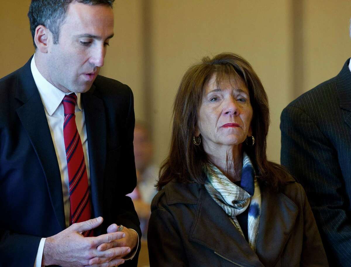Stamford High School Principal Donna Valentine becomes emotional as she appears in State Superior Court with her attorney, Mark Sherman, in Stamford, Conn., on Tuesday, November 19, 2014, where she was granted accelerated rehabilitation.