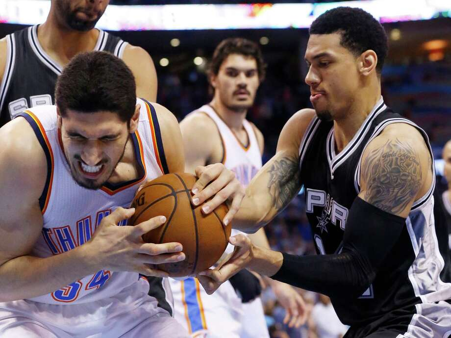 Oklahoma City Thunder center Enes Kanter, left, and Spurs guard Danny Green compete for the ball during the first quarter in Oklahoma City on April 7, 2015. Photo: Sue Ogrocki /Associated Press / AP