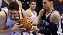 Oklahoma City Thunder center Enes Kanter, left, and San Antonio Spurs guard Danny Green compete for the ball during the first quarter in Oklahoma City, on April 7, 2015.