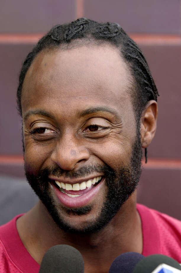 San Francisco 49ers wide receiver Jerry Rice smiles during a news conference at 49ers headquarters in Santa Clara, Calif., Wednesday, Dec. 13, 2000, as he talks about possibly playing his last home game at 3Com Park as a 49er this Sunday. (AP Photo/Paul Sakuma). HOUCHRON CAPTION (01/28/2001):  Rice.  HOUSTON CHRONICLE SPECIAL SECTION: SUPER BOWL XXXV. Photo: PAUL SAKUMA, STF / AP