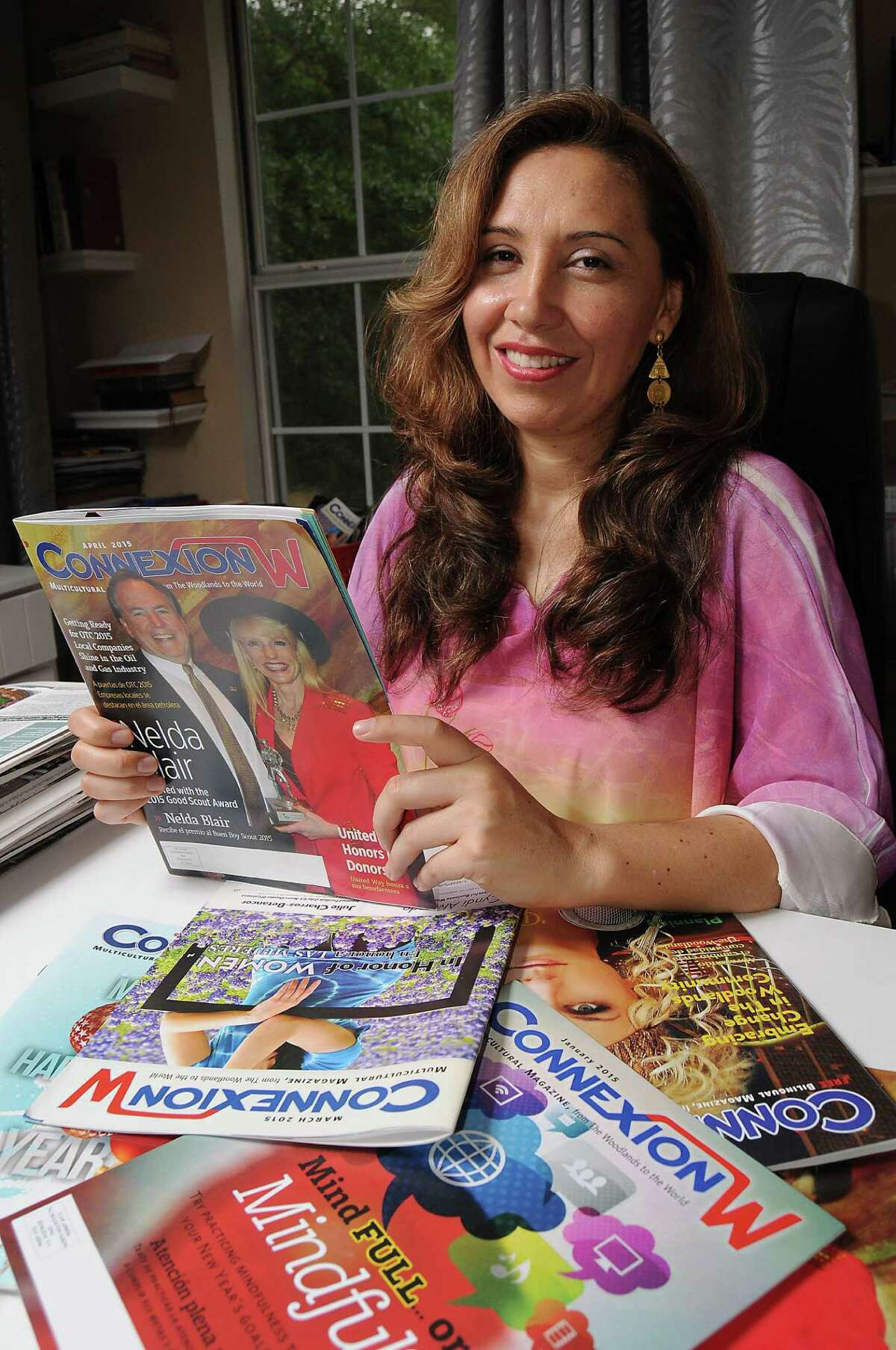 ConnexionW publisher Alba Malaver puts together the magazine from an office in her home with the help of her sister-in-law, Ruth Arce, who markets it and sells advertising.