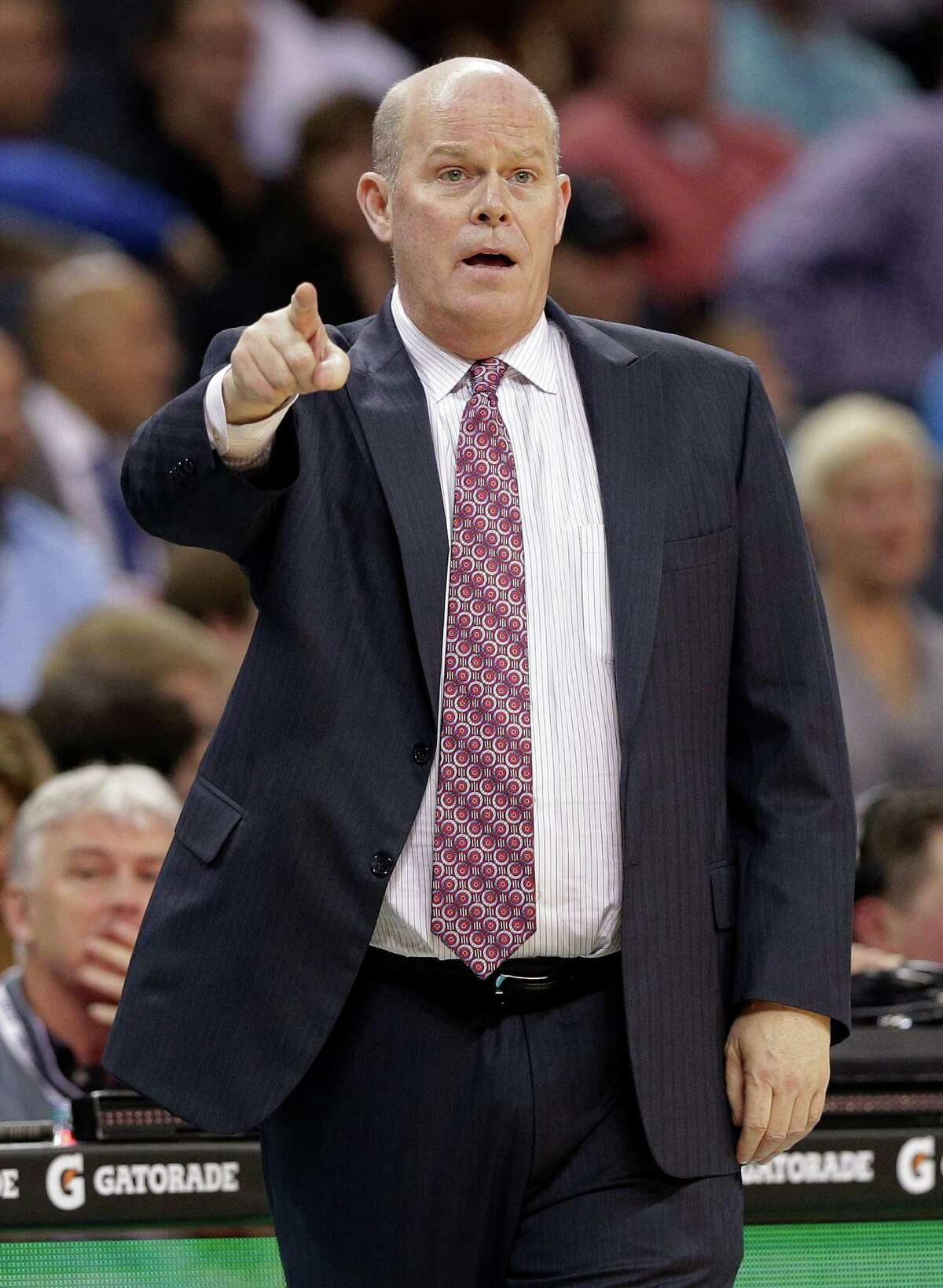 Charlotte Hornets coach Steve Clifford gestures to his players during the first half of the Hornets' NBA basketball game against the Houston Rockets in Charlotte, N.C., Monday, April 13, 2015. (AP Photo/Chuck Burton)
