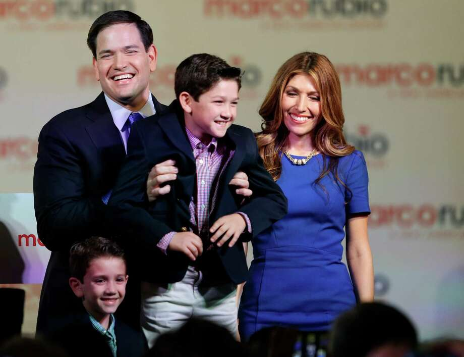 Florida Sen. Marco Rubio smiles onstage after his announce-ment on Monday in Miami with his family, sons Dominic, from left, and Anthony, and his wife, Jeanette. Photo: Wilfredo Lee, STF / AP