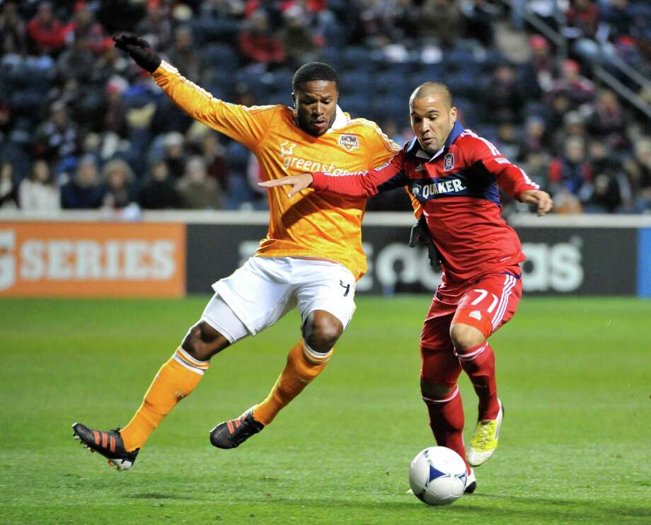 Alex of the Chicago Fire, right, battles the Dynamo's Jermaine Taylor in 2012. Alex, now with the Dynamo, has four goals and two assists in 77 MLS matches. Photo: David Banks, Stringer / 2012 Getty Images